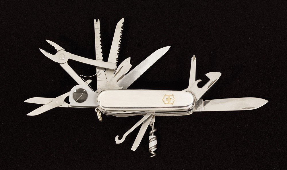 11:  a) Tiffany sterling silver Swiss Army knife is a V