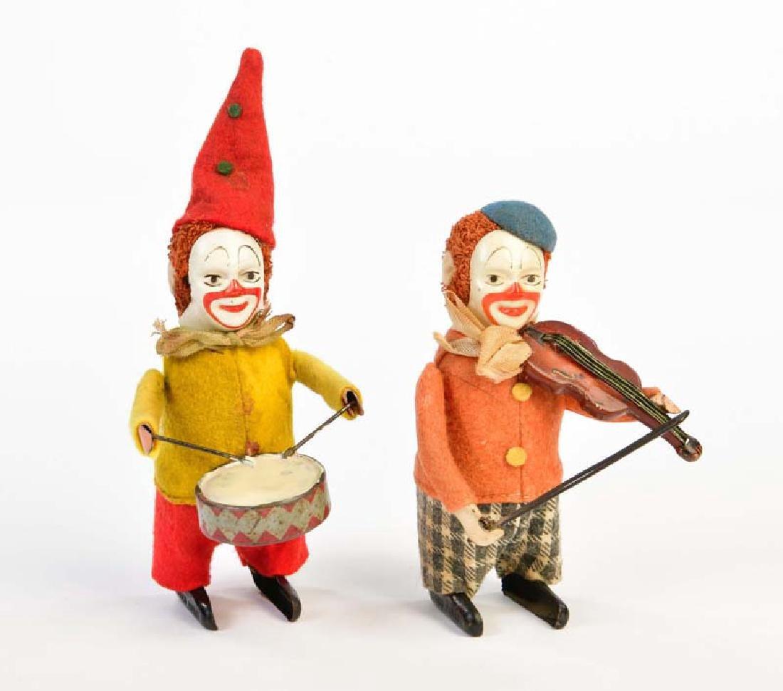 Schuco, Clown mit Trommel + Clown mit Geige