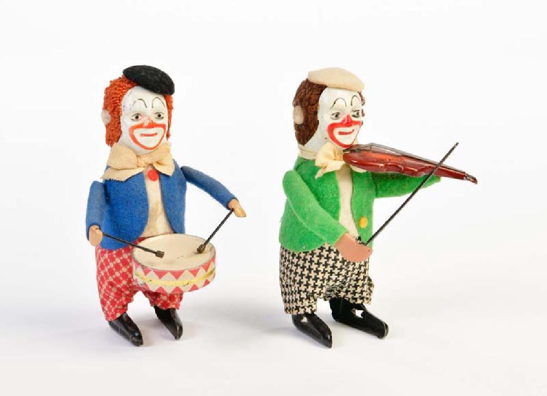 Schuco, Clown mit Geige + Clown mit Trommel