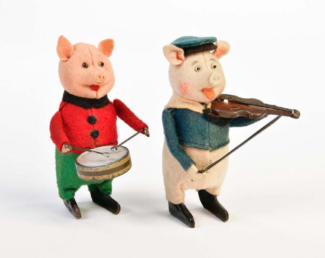 Schuco, Schwein mit Trommel + Schwein mit Geige