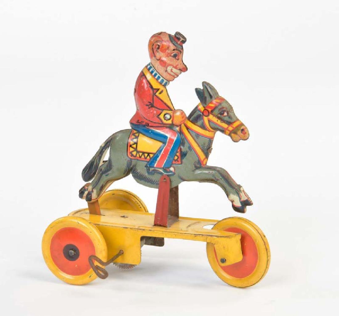 Bell, Clown auf Esel