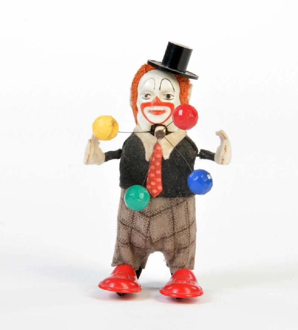 Schuco, Tanzfigur Clown mit Baellen