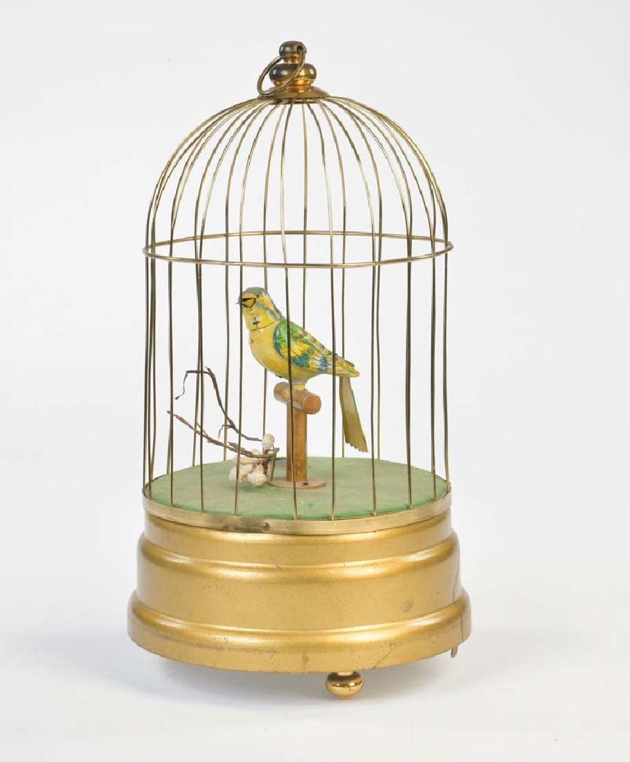 Koehler, Vogel im Kaefig