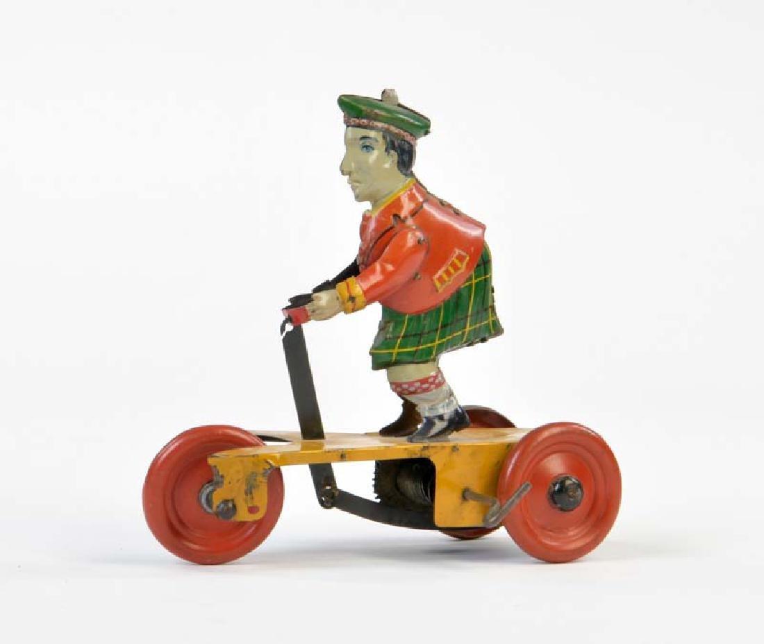 Guenthermann, Schotte auf  Dreirad