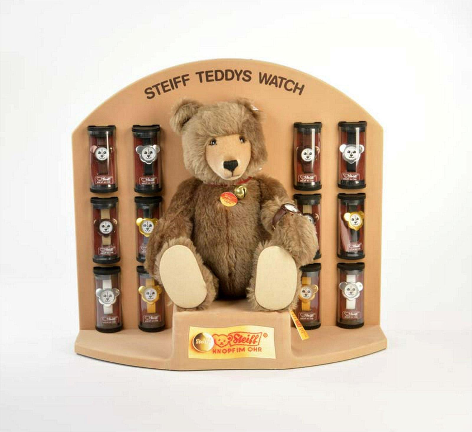 Steiff, Watch Teddy mit Uhr + 12 Steiff Uhren in