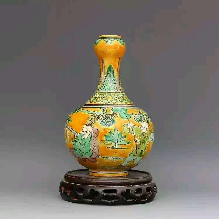 A yellow glazed famille rose porcelain vase