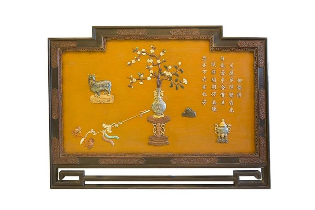 Chinese wood panel with inlaid carved precious stone.
