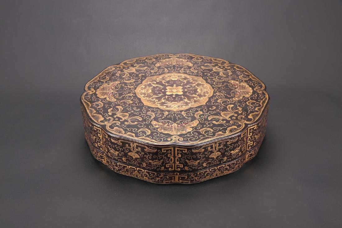 Chinese gilted black lacquer box, Qianlong mark.