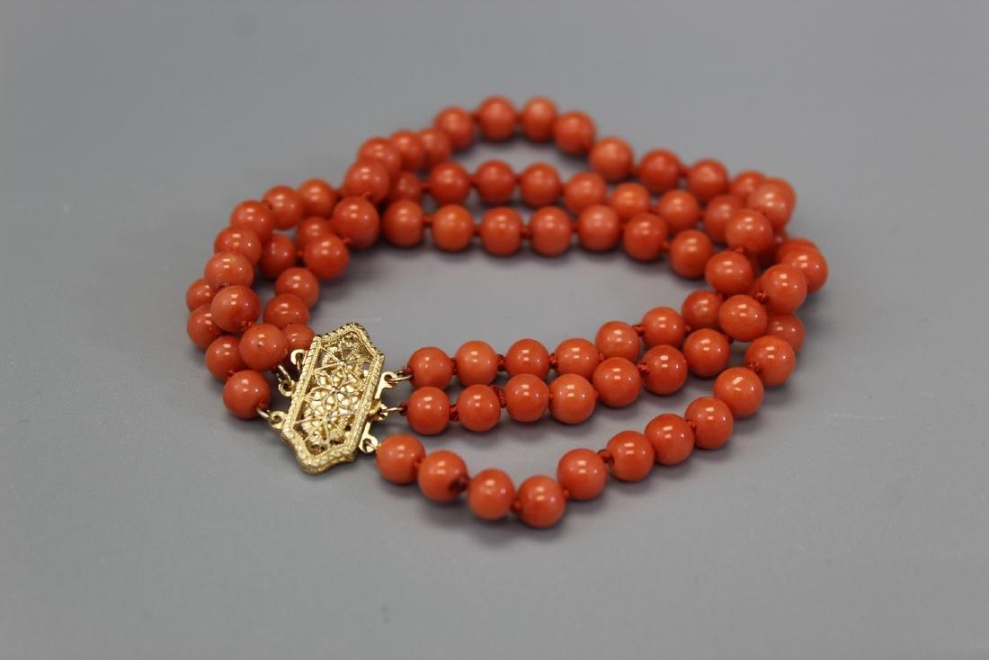 14K gold red coral bracelet.