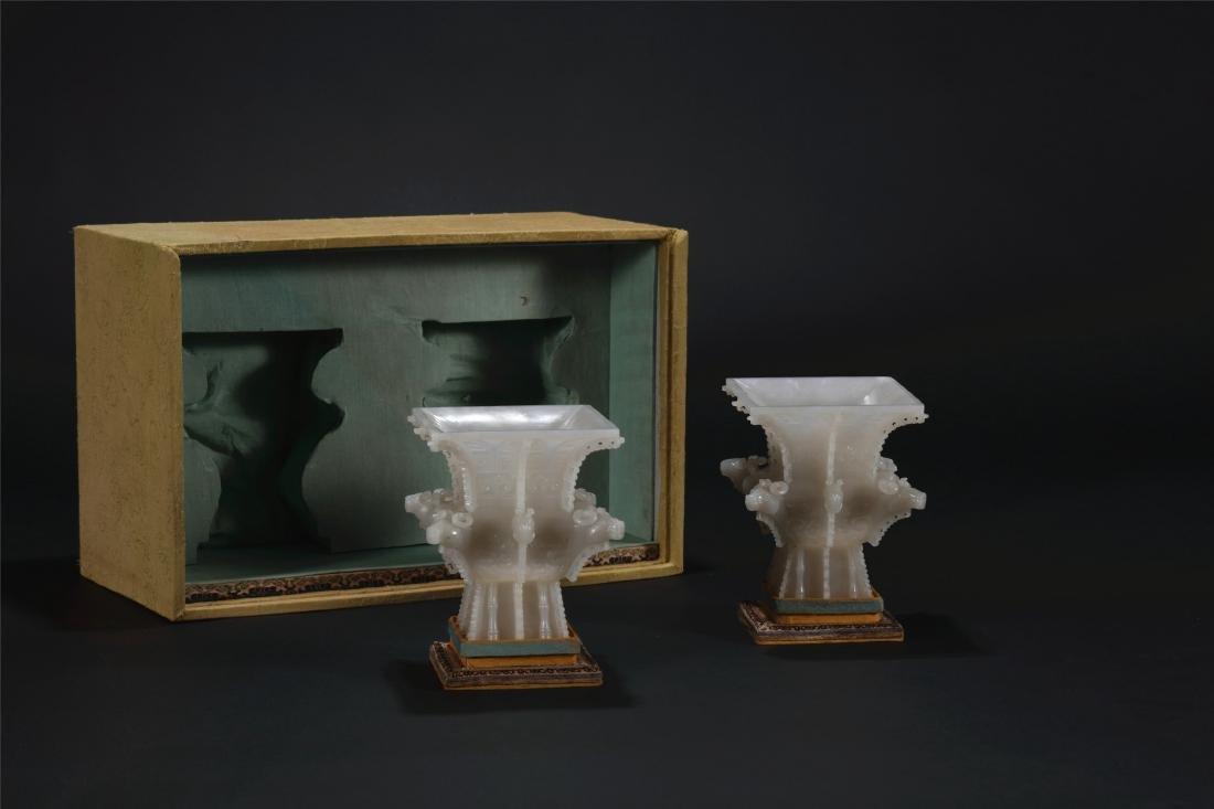 Pair of Chinese carved white jade zun