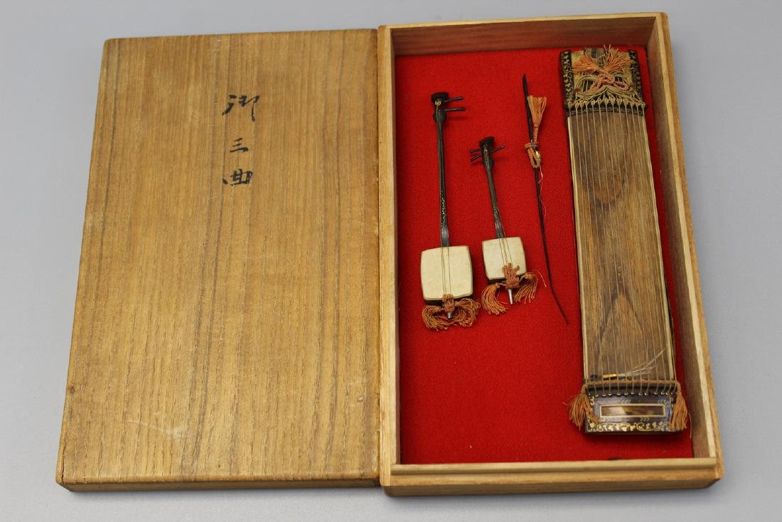 Vintage Japanese miniature instrument in the wood box,