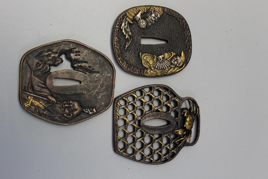 Three Japanese tsuba.