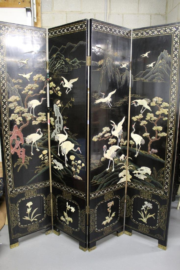 Four-panel lacquered screens with soapstone decoration.