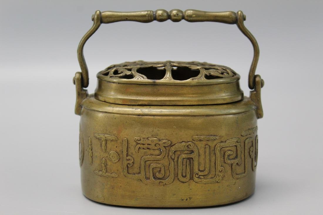 Chinese bronze hand warmer, marked.  Provenance: