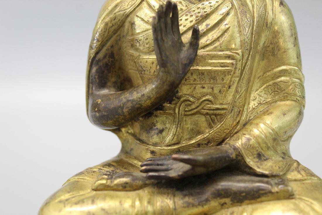 Chinese gilt bronze figure. - 3