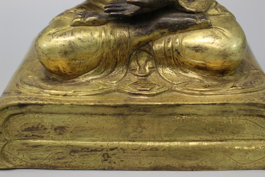 Chinese gilt bronze figure. - 4