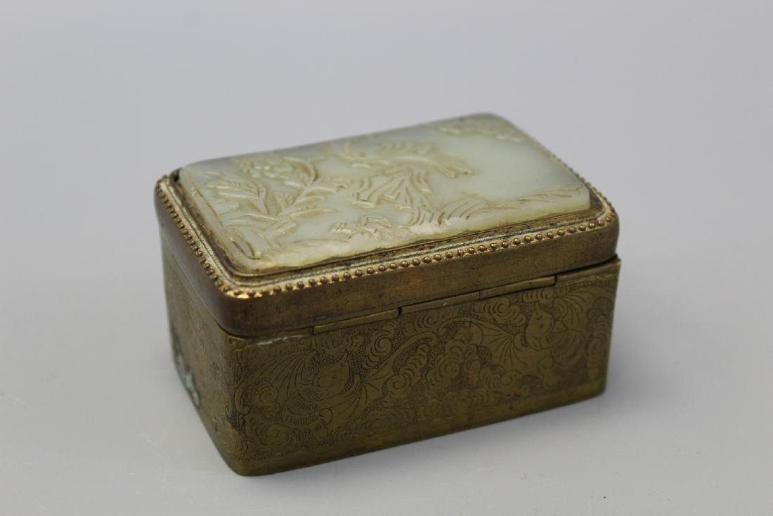 Chinese metal box with carved white jade top.