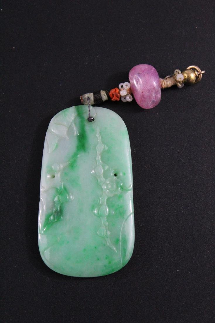 Chinese carved jadeite pendant.