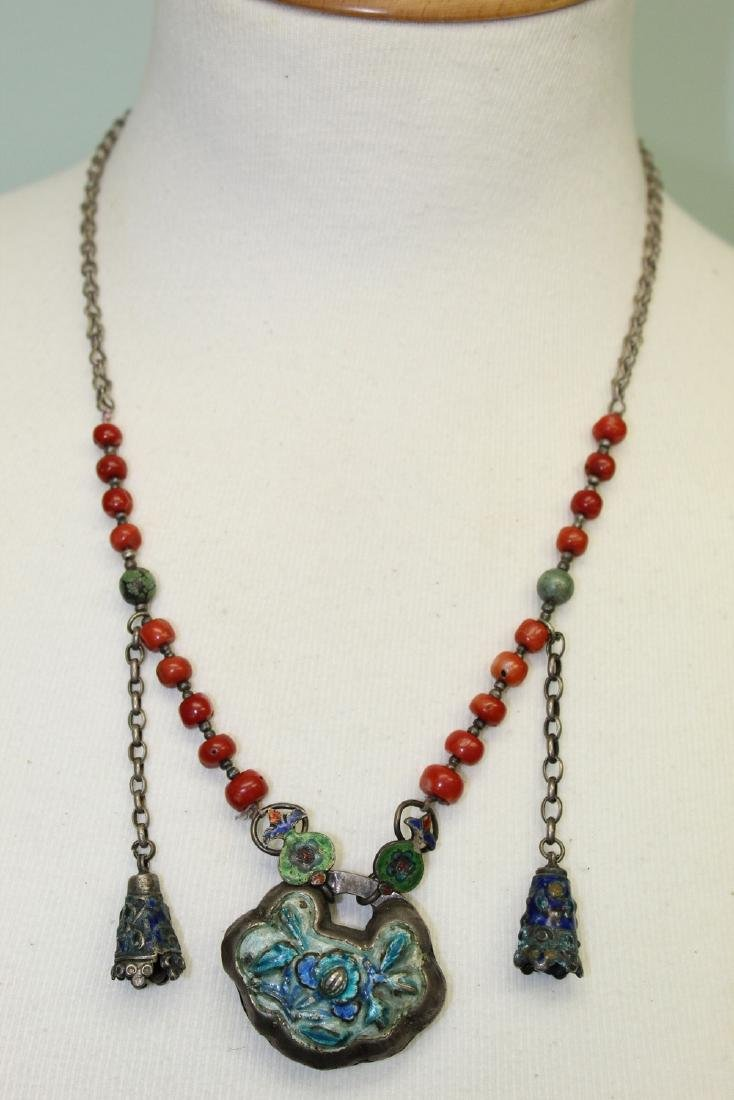 Chinese red coral necklace with silver pendant.
