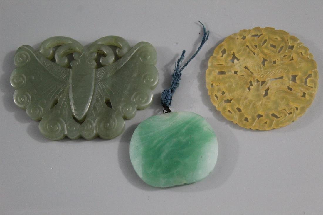 Three Chinese carved jade pendants.