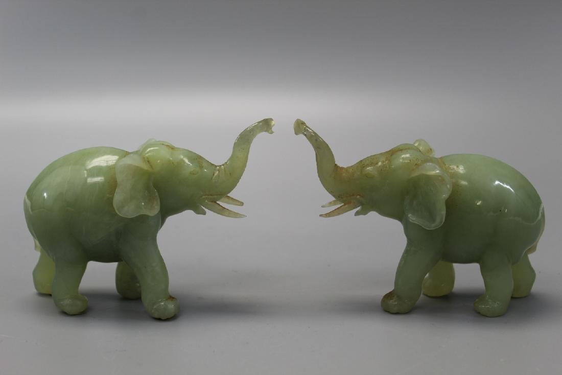 Two carved jade elephants.