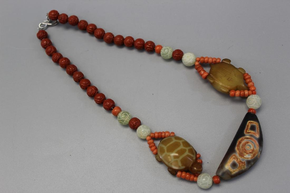 Chinese red coral and DZi beads necklace.