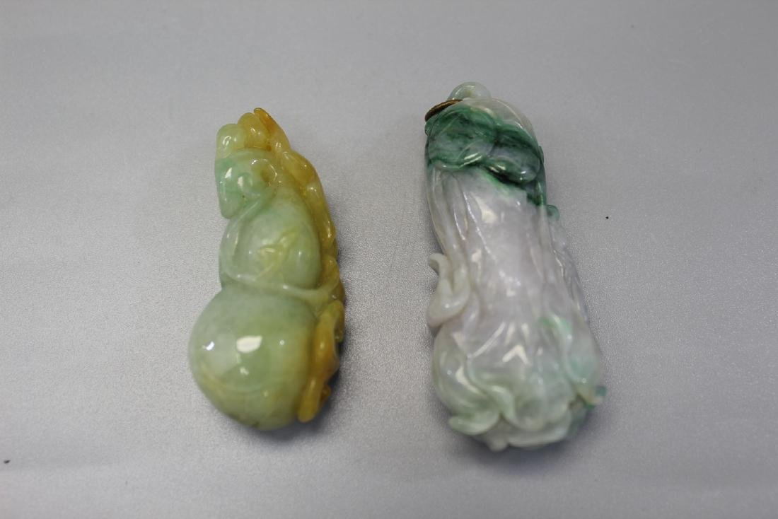 Two Chinese carved jadeite pendants.