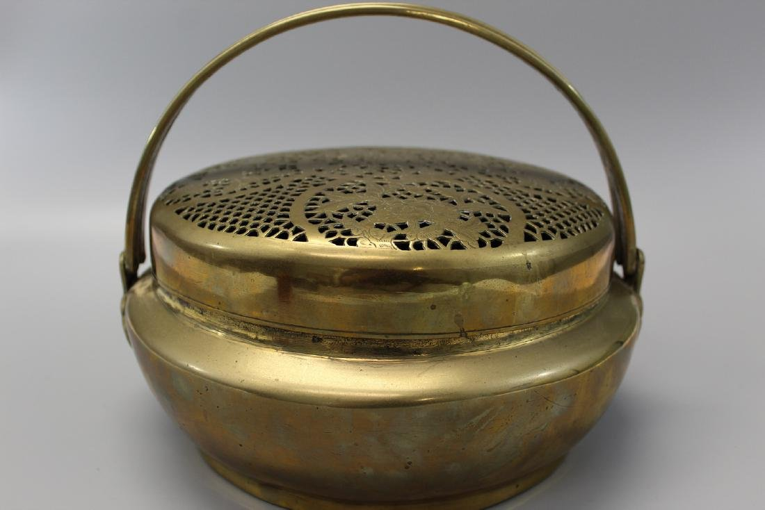 Chinese brass hand warmer.