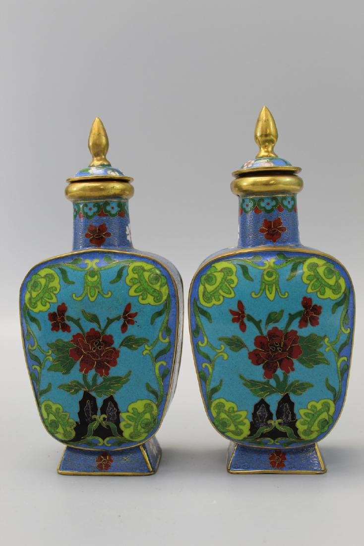 Pair of Chinese cloisonne vases with lids.