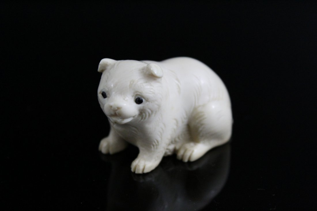 Japanese carved netsuke of a dog.