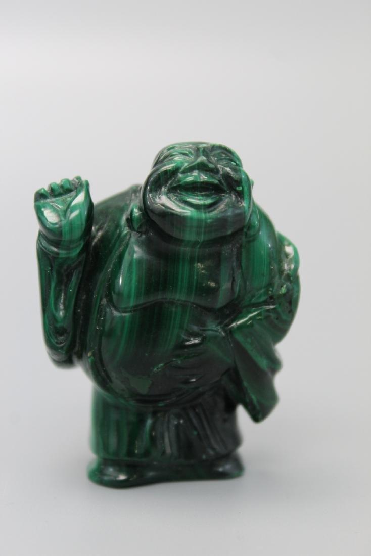 Japanese carved malachite netsuke of a laughing buddha.