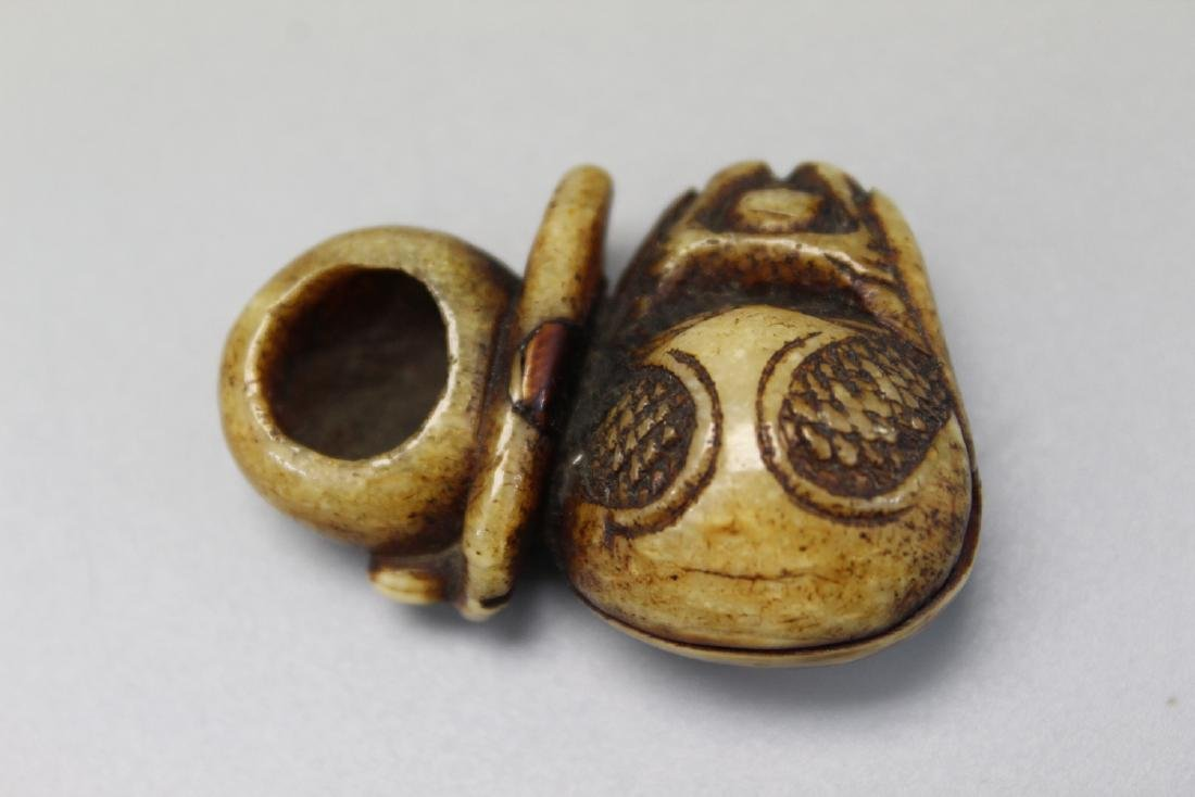 Japanese carved bone netsuke of a mokugyo.