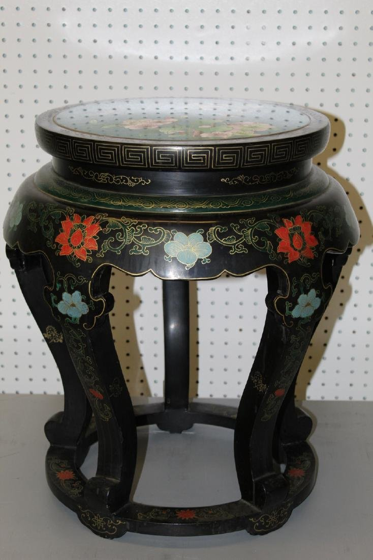 Chinese lacquered stool with cloisonne top.