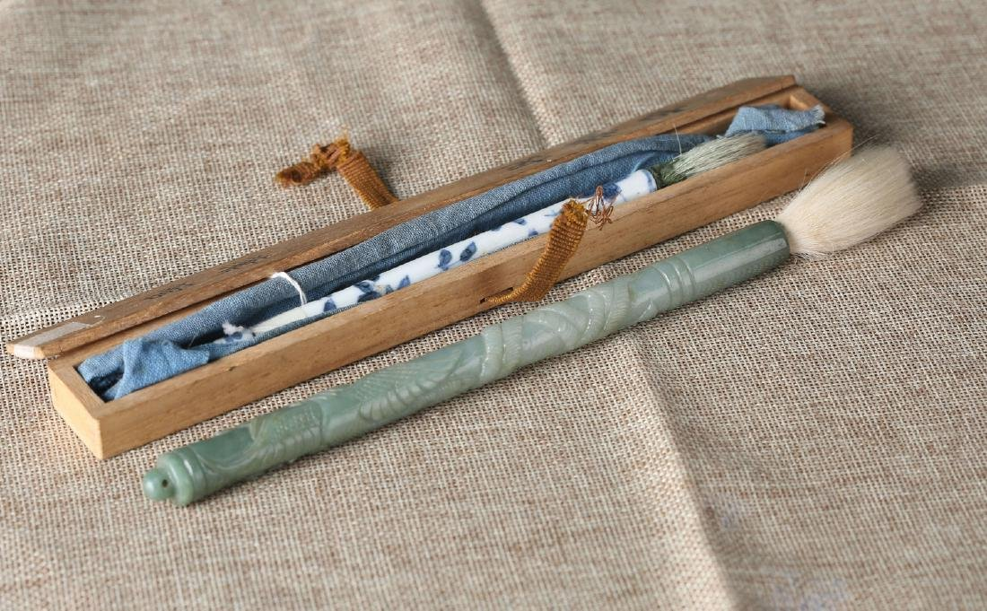 Chinese blue and white porcelain and jade brushes.