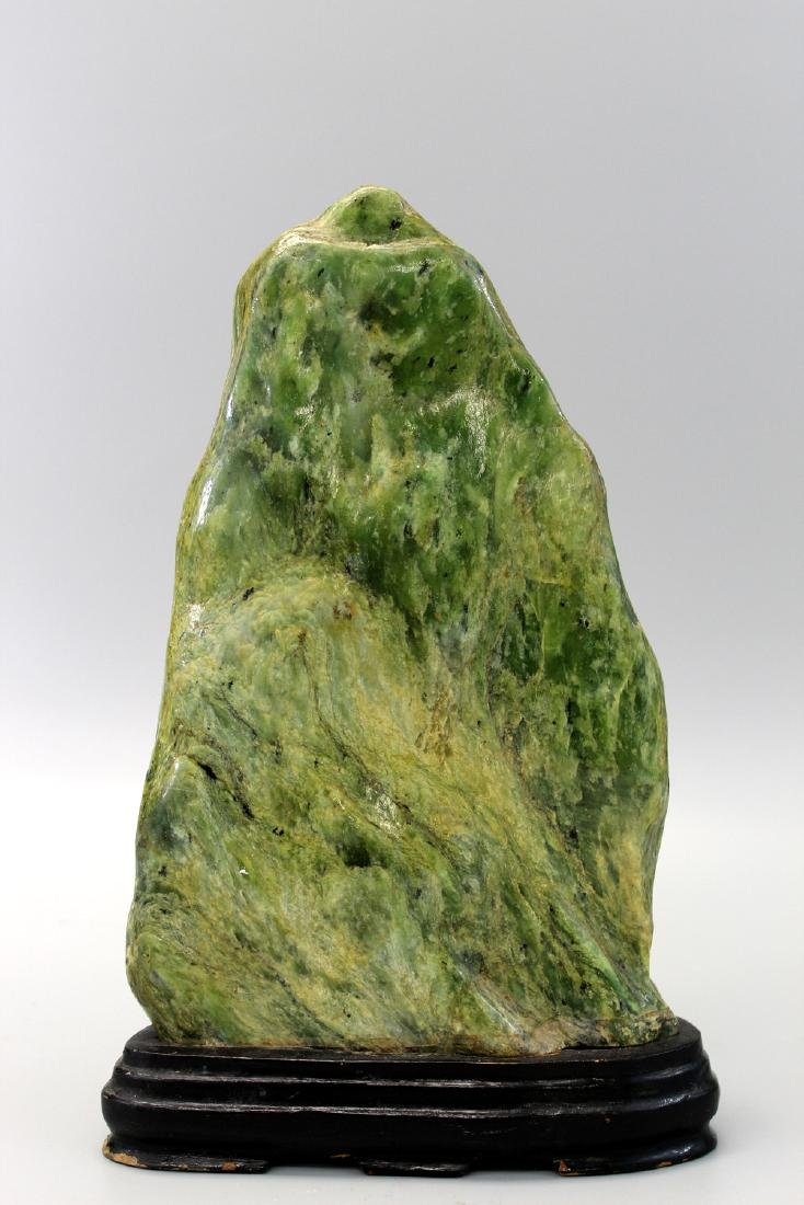 Jade boulder with wood stand.