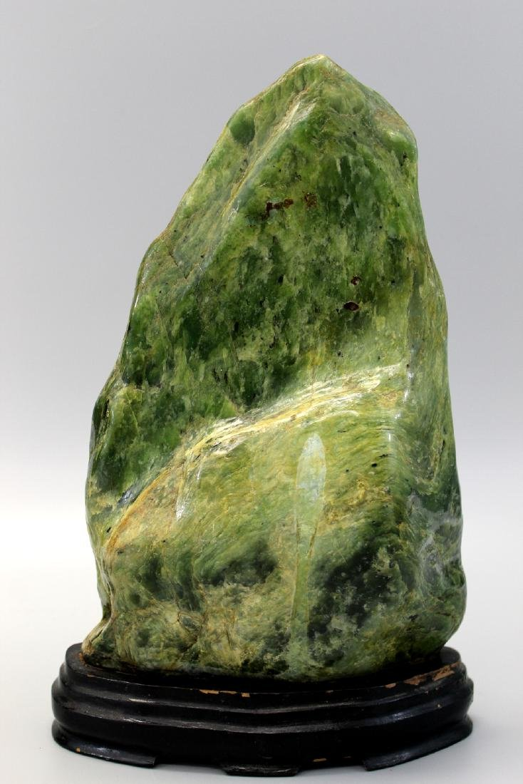Jade boulder with wood stand. - 2