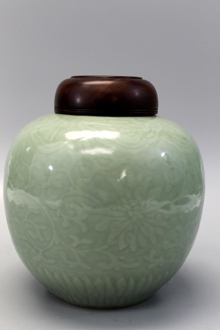 Chinese celadon porcelain jar with wood lid.