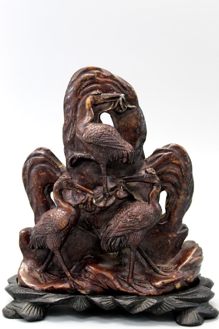 Chinese carved soapstone on wood stand.
