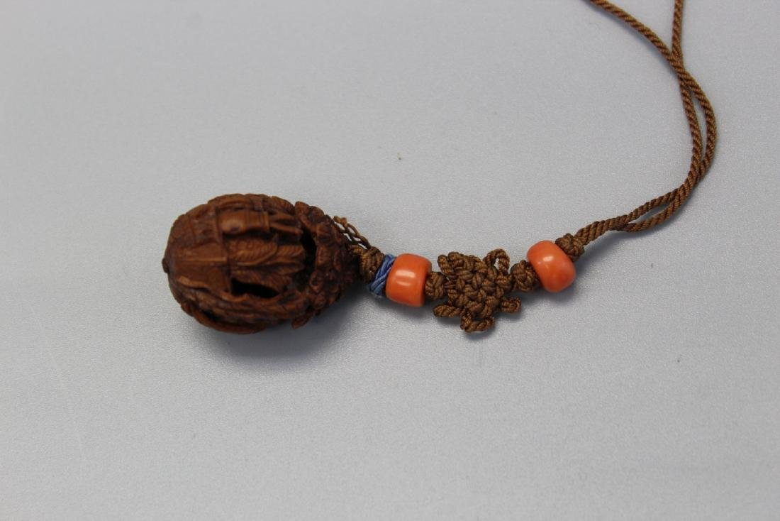 A carved walnut toggle.