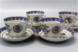 Set of four 4 Chinese famille rose cups and saucers