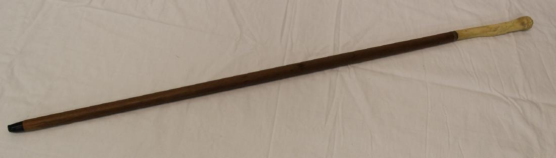Vintage cane with carved bone handle.