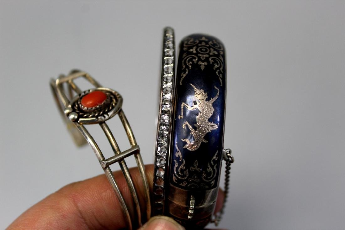 Three sterling silver bangles. One with red coral - 2