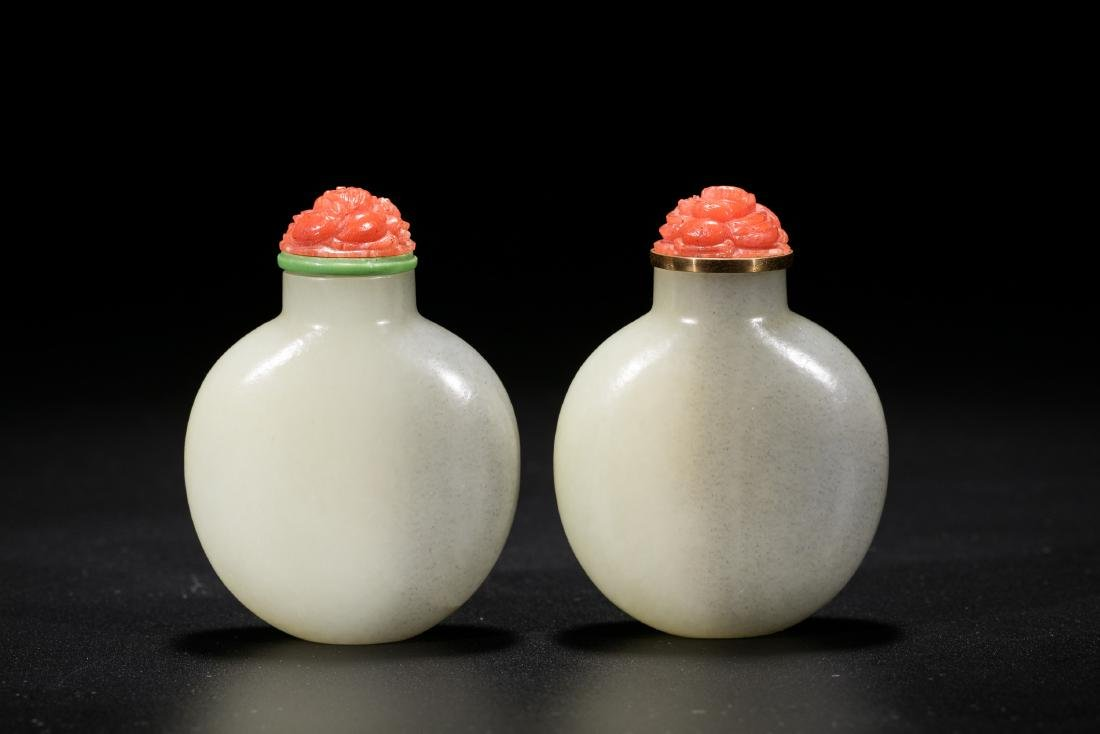 A pair of Chinese white jade snuff bottles. 19th