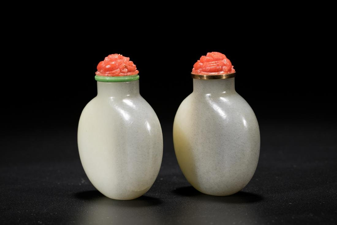 A pair of Chinese white jade snuff bottles. 19th - 2