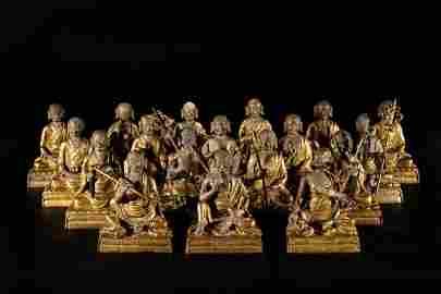 A set of eighteen Chinese gilt bronze luohan statues.