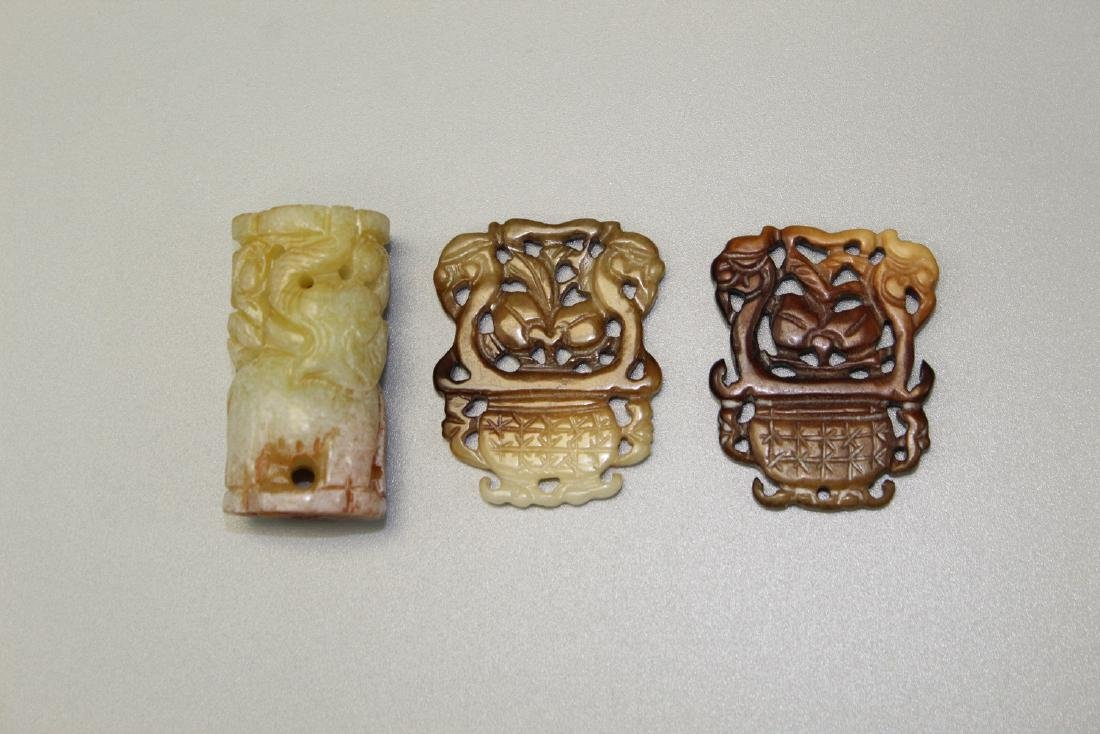 Three Chinese carved jade pendants.