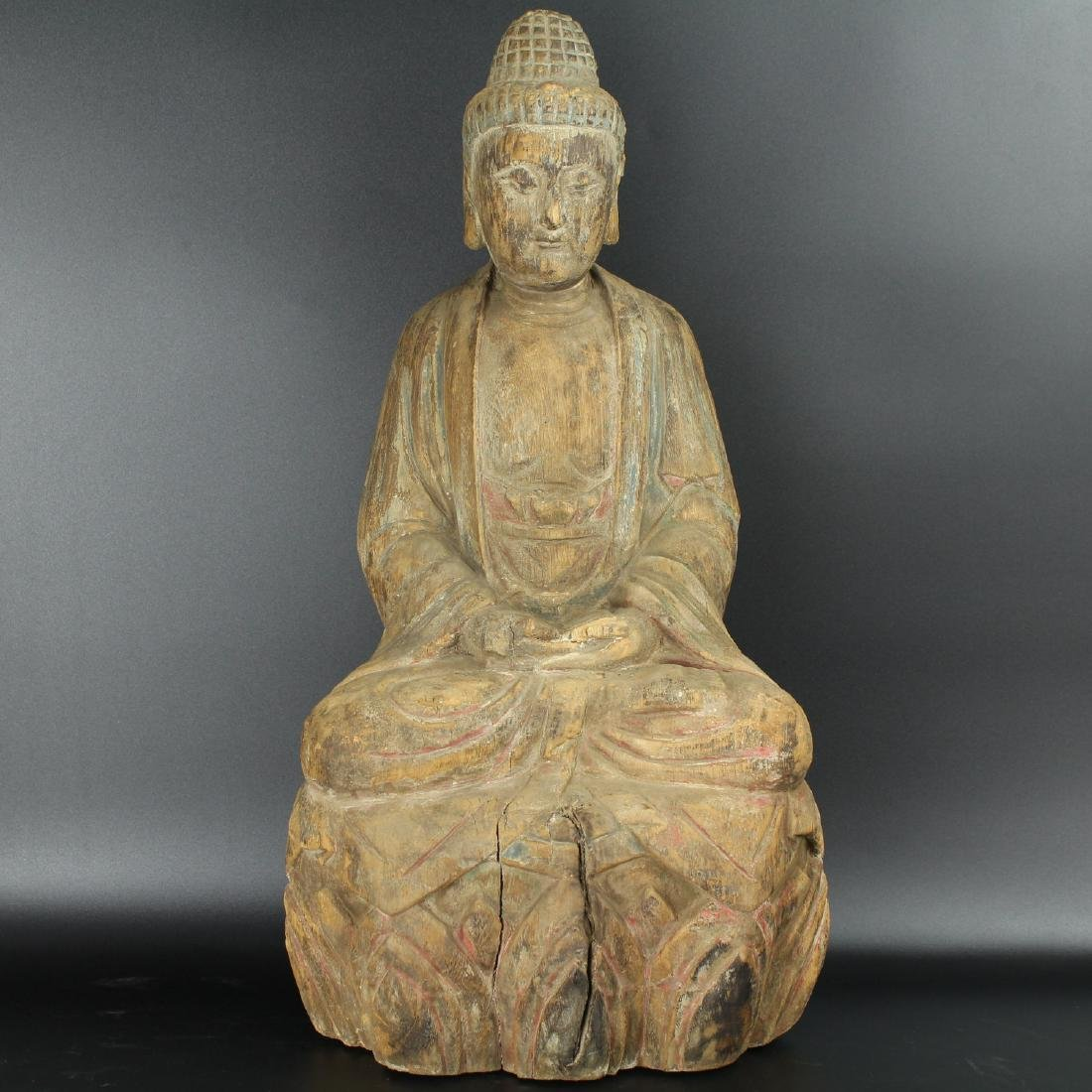 Chinese carved wood figure of a Buddha.