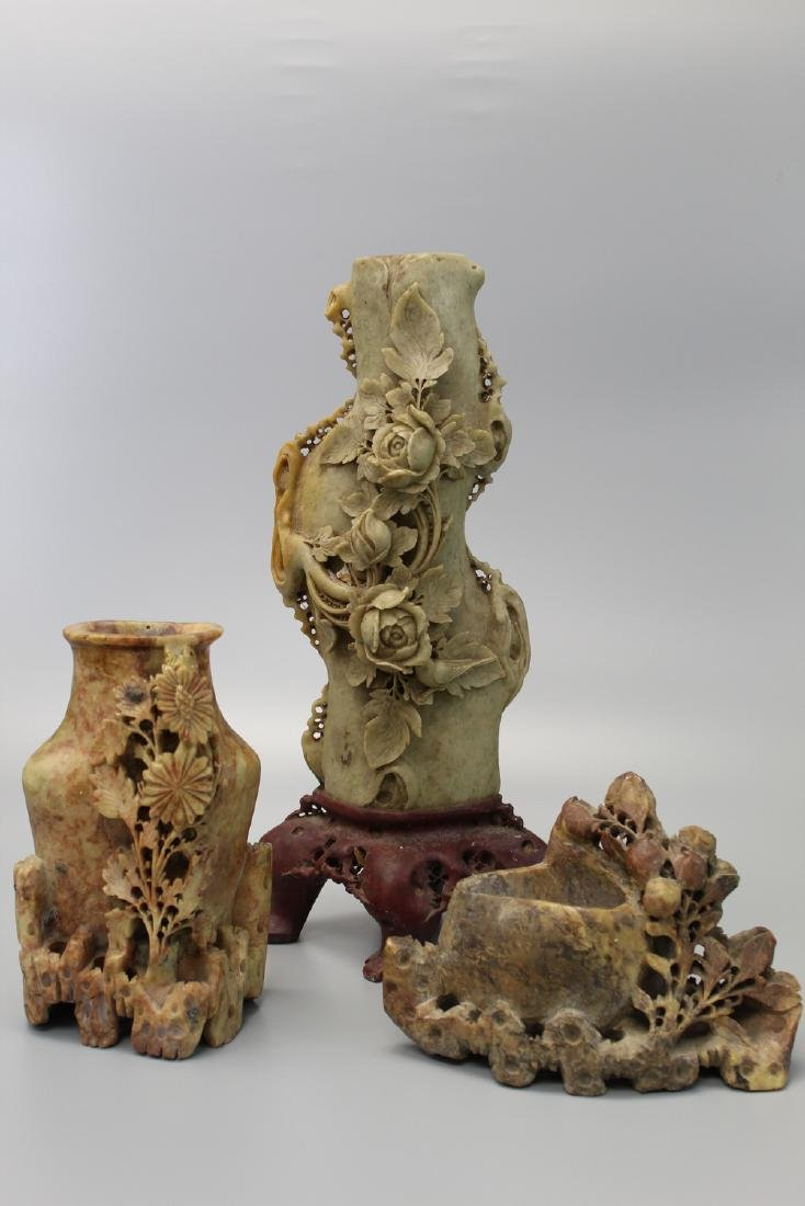 Three Chinese soapstone carvings.