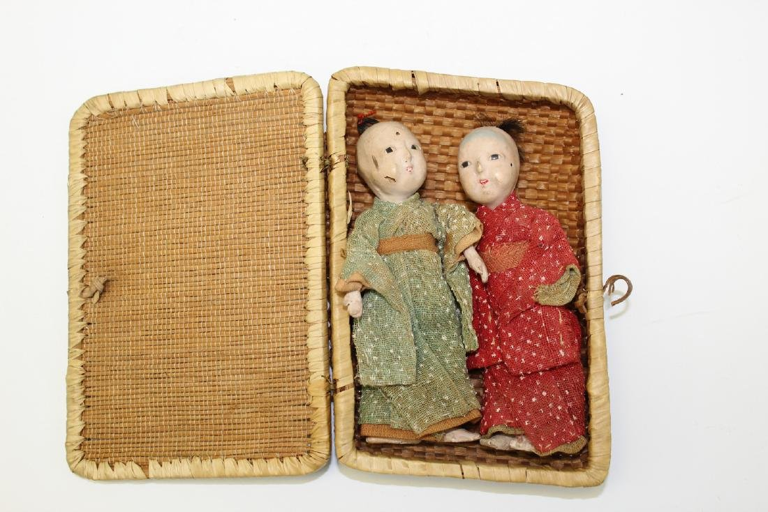 Two Japanese Miniature Dolls in a Bamboo Box.