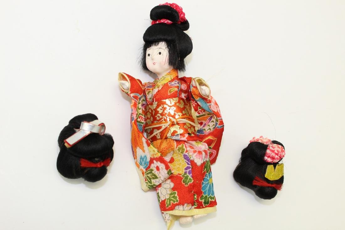 Vintage Japanese Doll with 3 wigs.
